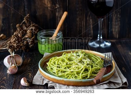 Pasta Spaghetti With Pesto Sauce On A Wooden Background. National Kitchen. Healthy Eating. Vegetaria