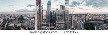 Panorama High-rise Buildings And Transport Of Metropolis, Traffic And Blurry Lights Of Cars On Multi