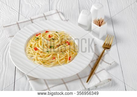 Close-up Of Pasta Aglio, Olio E Peperoncino, Italian Spaghetti With Garlic, Chili Pepper And Olive O