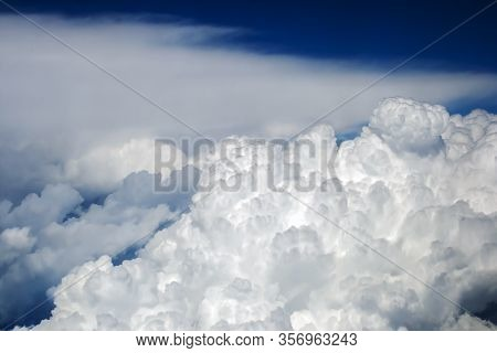 Aerial View On Incredibly Wonderful Lush Cumulus Clouds Against A Blue Sky.