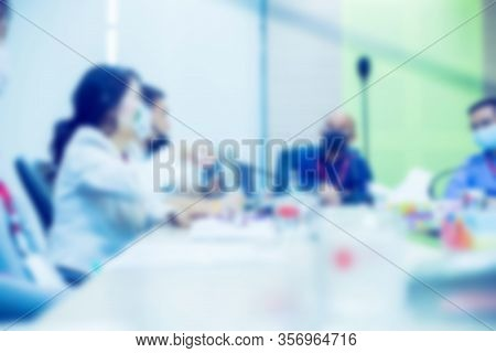 Blurry Image Of Business People Wear Masks To Prevent Coronavirus (covid-19) In Meeting Room. Startu