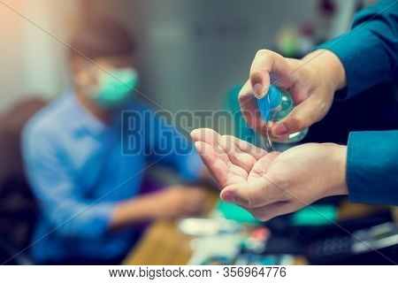 Washing Hands With Alcohol Sanitizer To Avoid Contaminating With Coronavirus Covid-19. Washing Hand