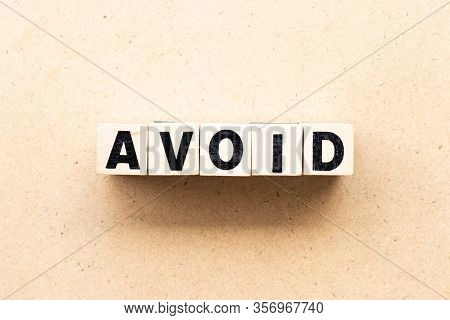 Letter Block In Word Avoid On Wood Background