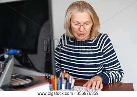 Woman Middle Aged In Glasses Using Laptop Typing Email Working At Home Office, Lady Searching Inform