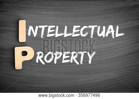 Ip - Intellectual Property Acronym, Business Concept On Blackboard