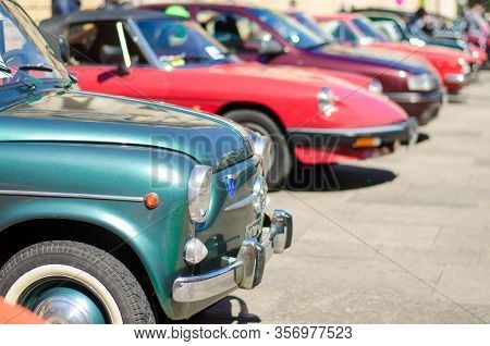 Lecce, Italy - April 23, 2016: Front Left Side View Of Row Of Colourful Vintage Classic Retro Automo