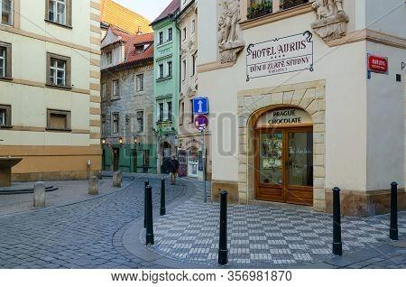 Prague, Czech Republic - January 21, 2019: Unknown Elderly Man Walk In Historic Center Of City (star