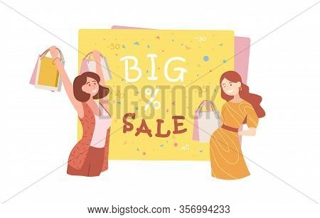 Two Happy Young Woman Shoppers Carrying Bags Of Purchases With A Sale Sign Showing Percentage Reduct