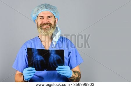 Health Problems. Surgery Operation And Medical Concept. Man Look At Roentgen. Radiologist Hold Xray.