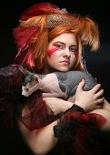 yong princess with cat. creative fantasy make-up. poster