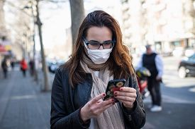 Beautiful With Mask On Street. Covid-19 Protection. Woman Protecting From Coronavirus. Coronavirus.