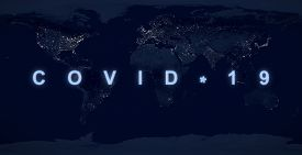 Covid-19 Pandemic Concept, Name Covid On Dark Night Planet Map. World Economy Hit By Coronavirus Out