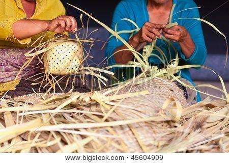 Balinese Women Make Baskets For Offerings