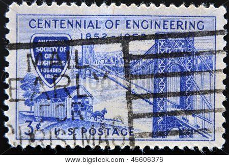 stamp printed in USA shows George Washington Bridge and Covered Bridge of 1850s