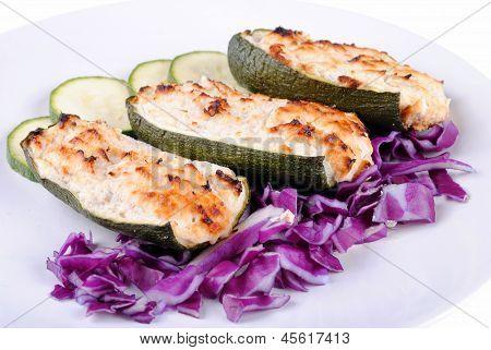 stuffed zucchini with tuna and cheese on white