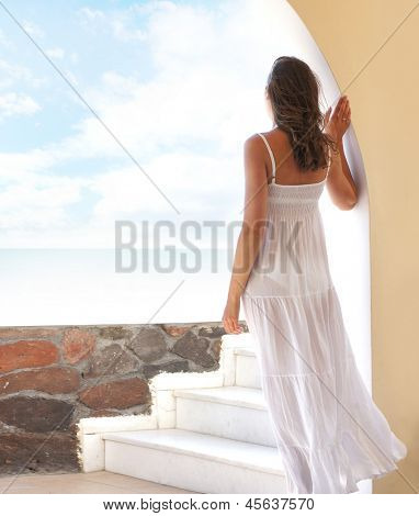 Young attractive woman chilling at the resort. Image has a lot of blank space.