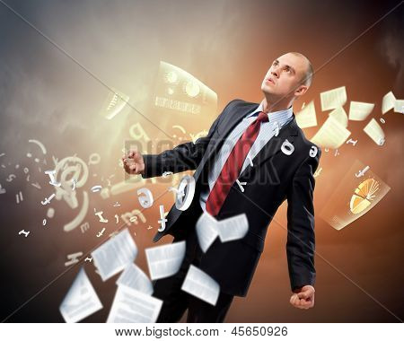 Image of young businessman in anger against illustration background