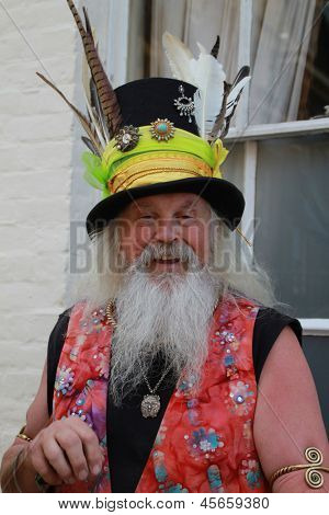 ROCHESTER, UK - MAY 5 : Man with traditional costume and feathers in hat at Rochester Sweeps Festival in Rochester, England on May 5, 2013
