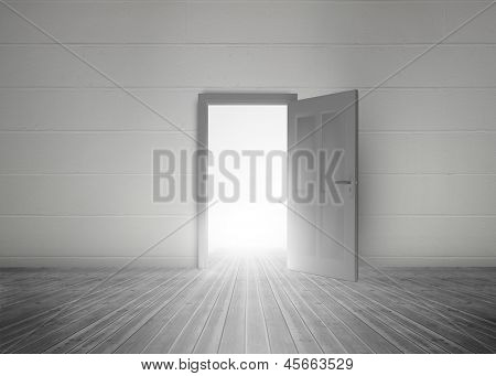 Door opening to reveal bright light in a dull grey room