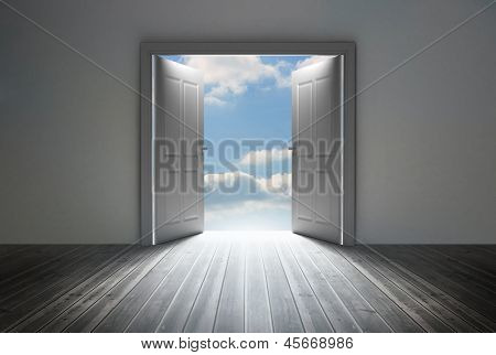Doorway revealing bright blue sky in dull grey room