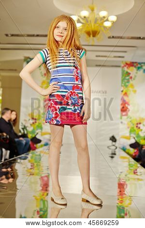 MOSCOW - MAR 17: Girl model in colourful gown at podium of Children Gallery Yakimanka during 5th Yakimanka Kids Fashion Week, March 17, 2012, Moscow, Russia.