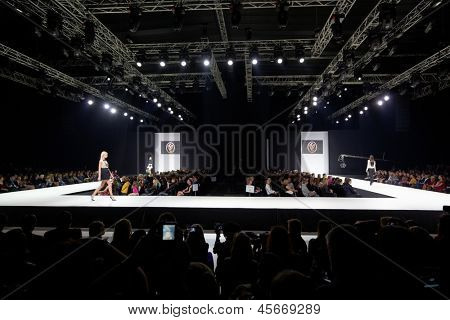 MOSCOW - APR 4: Models walk at podium in Gostiny Dvor during Volvo Fashion Week, April 4, 2012, Moscow, Russia. Gostiny Dvor is one of most mesmerizing historical buildings in Moscow.