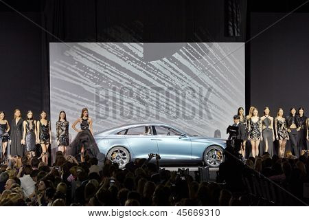 MOSCOW - APR 4: Valentin Yudashkin and his models at podium in Gostiny Dvor next to sports car Volvo during opening of 27th Volvo Fashion Week, April 4, 2012, Moscow, Russia.