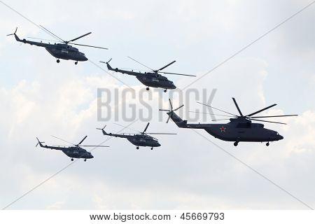 ZHUKOVSKY - AUGUST 12: Russian aerobatic team Berkuts on Mi-28 at airshow devoted to 100 anniversary of Russian Air Forces on August 12, 2012 in Zhukovsky, Moscow region, Russia.