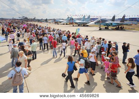ZHUKOVSKY - AUGUST 12: Spectators and journalists on airshow devoted to 100 anniversary of Russian Air Forces on August 12, 2012 in Zhukovsky, Moscow region, Russia.