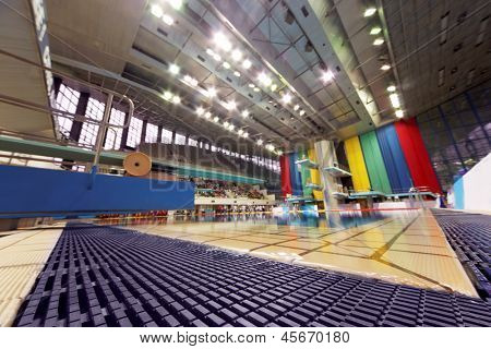 MOSCOW - APR 13: Pool of SC on day of third phase of the World Series of FINA Diving, low angle view, April 13, 2012, Moscow, Russia. Jumping sector of pool equipped for 4,500 spectators.