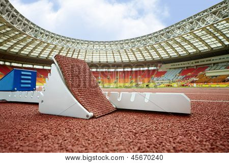 MOSCOW - JUN 11: Starting blocks on race track for steeplechase at Grand Sports Arena of Luzhniki OC at athletics competitions IAAF World Challenge Moscow Challenge, June 11, 2012, Moscow, Russia.
