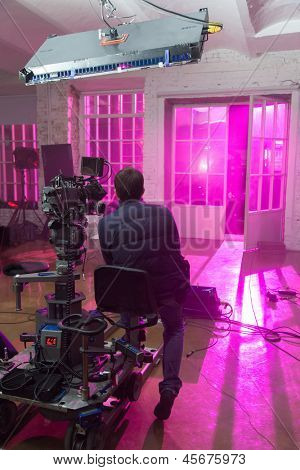 The camera shoots a scene with purple room, filmed in a rented public studio.