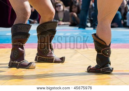 The fighters in national boots are ready to Mongolian wrestling.