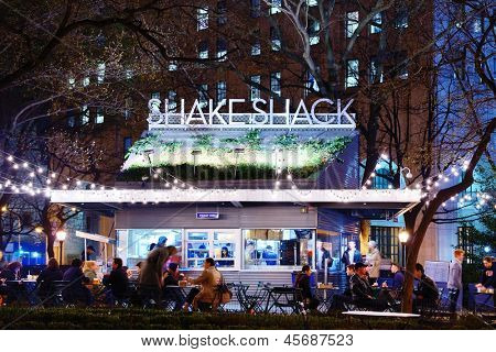 NEW YORK CITY - APRIL 15: Customers dine at Shake Shack in Madison Square Park April 15, 2013 in New York, NY. The chain diner opened in 2004 and the Madison Square Park location is the original.