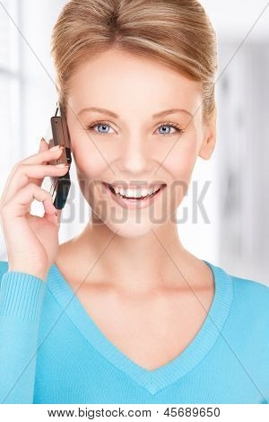 picture of happy businesswoman with phone in office