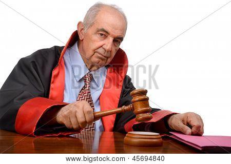Senior adult judge with gavel isolated on white background