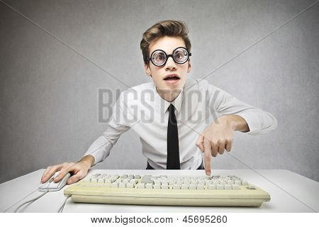 young businessman writing with the computer keyboard