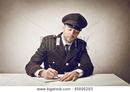 young carabiniere writing poster