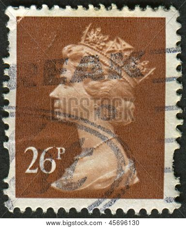 UK-CIRCA 1990: A stamp printed in UK shows image of Elizabeth II is the constitutional monarch of 16 sovereign states known as the Commonwealth realms, in Drab, circa 1990.