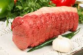 close up of beef round steak in vegetable background poster
