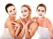 Group women with  facial mask in beauty spa. poster