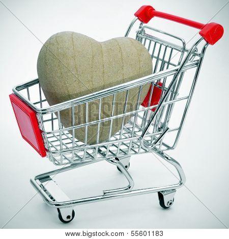 a papier-mache heart in a shopping cart