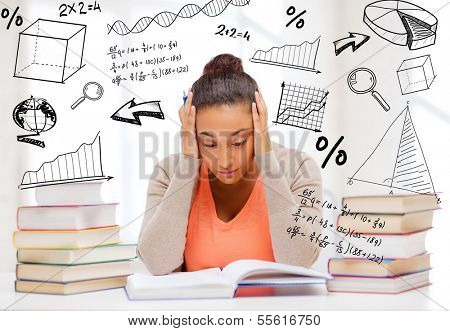 education and college concept - tired student with pile of books and notes studying indoors