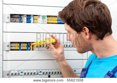 Repairman Fixing A Switchboard