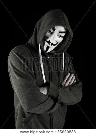 Hooded man wearing v for vendetta mask