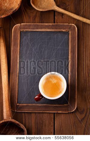 espresso coffee with retro kitchen utensils  wood spoon on old wooden table in rustic style