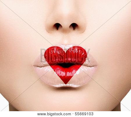 Valentine Heart Kiss on the Lips. Makeup. Beauty Sexy Lips with Heart Shape paint. Valentines Day. Beautiful Love Make-up
