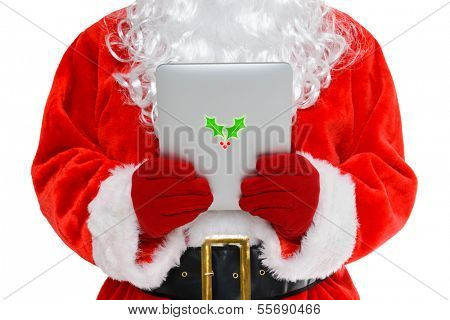 Santa Claus or Father Christmas looking at his mobile tablet computer, isolated on a white background.