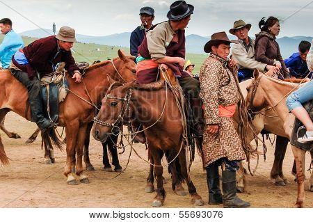 STEPPE OUTSIDE ULAANBAATAR, MONGOLIA - JULY 12, 2010: Mongolians at Nadaam horse race