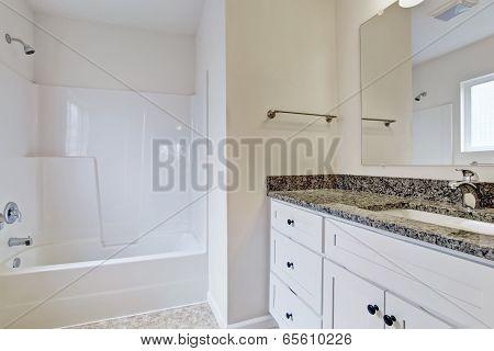 Emtpy Bathroom With White Refreshing Tub